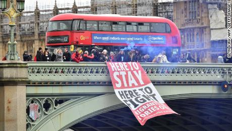 Pro-EU, anti-Brexit protesters held a banner and smoke flares during a demonstration on Westminster Bridge in London Friday.