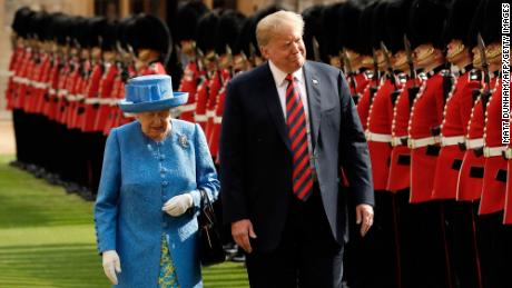 Queen Elizabeth II and Donald Trump inspect the guard of honour formed of the Coldstream Guards during a welcome ceremony at Windsor Castle in Windsor on July 13, 2018