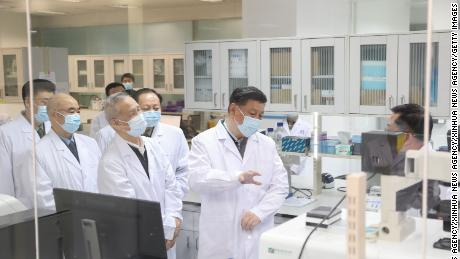Chinese President Xi Jinping learns about the progress on a candidate coronavirus vaccine during his visit to the Academy of Military Medical Sciences in Beijing in March.