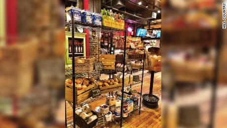 Hill Country, in New York City, is selling groceries to customers.
