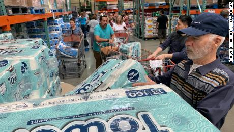 In early March, customers lined up to buy toilet paper, fearing that the coronavirus would spread and force people to stay inside. (Robyn Beck / AFP / Getty Images)