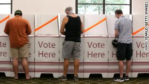 Voters keep a distance in Brisbane, Australia, on March 28.