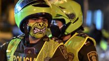 Police wear colorful masks in Cali, Colombia on March 20, as preventive measures have started.