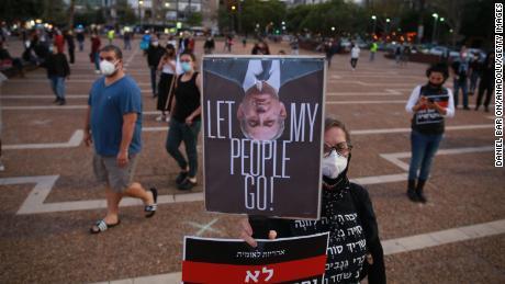 Israelis protest at Rabin Square in Tel Aviv on Sunday.