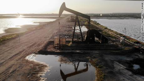 World oil prices hit 21-year low, but equity markets edged up
