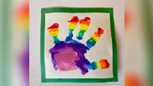 Prince Louis painted his own rainbow image, using a handprint.