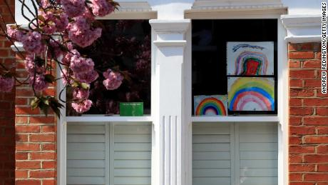 Homemade designs of a rainbow are shown in a window on April 9 in London, England.