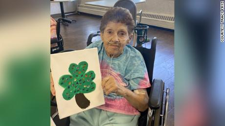 Fryz's mother Loretta posed with a shamrock last month.