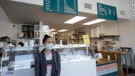 Rica Sunga-Kwan, owner of Churn Urban Creamery, wears a mask during an interview in her San Francisco store on Thursday, April 23.