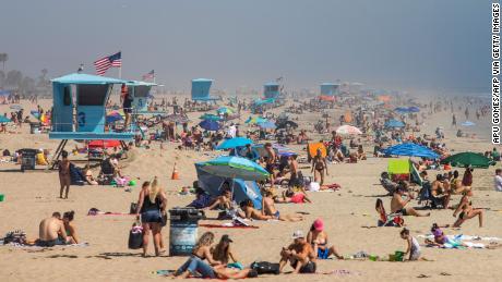 People invade southern California beaches despite coronavirus problems