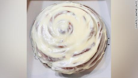 Whitney Rutz makes giant cinnamon rolls for healthcare professionals.