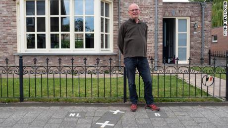 Though most of Julien Leemans' house is in the Netherlands, his front door is in Belgium.