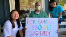 Michael Herbert is greeted by his daughters after being in the hospital with Covid-19.