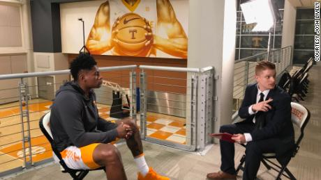 Sanning, here interviewing then-UT player Admiral Schofield, says he's known he wanted to be a sports reporter since his mid-teens.