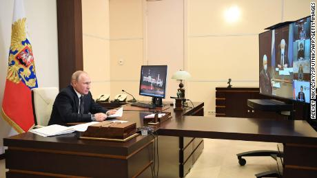 Russian President Vladimir Putin holds a coronavirus videoconference with officials from Dagestan on May 18.