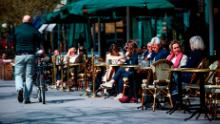 People sit in a restaurant in Stockholm on May 8, 2020, during the coronavirus pandemic.