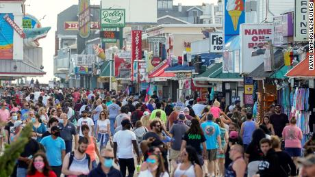 Some Americans take vacations far from social distance and officials fear future spikes in coronavirus cases