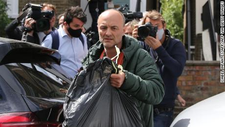 Dominic Cummings leaves his home surrounded by media in London on May 24, 2020 following allegations he broke coronavirus lockdown rules by traveling across the country in March.