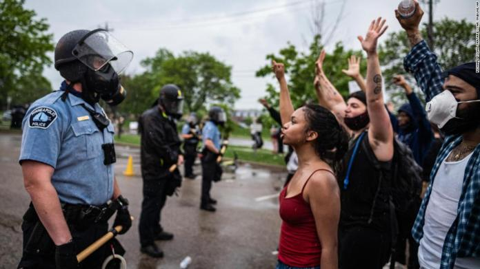 Protesters and police face off during a rally in Minneapolis on May 26.