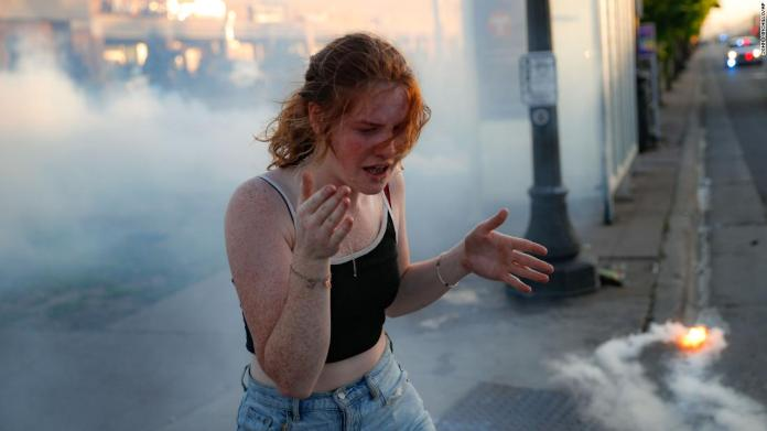 A protester reacts amid a cloud of tear gas in St. Paul on May 28.