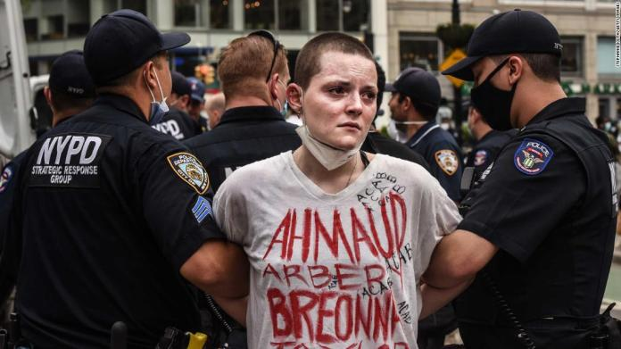 A protester is detained by police during a rally in New York City's Union Square on May 28.
