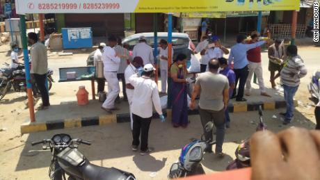 Volunteers  distribute food to migrants on National Highway 44.
