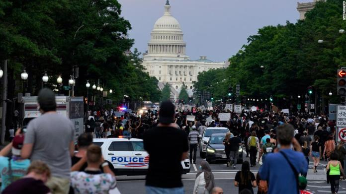 Demonstrators walk along Pennsylvania Avenue in Washington on May 29.