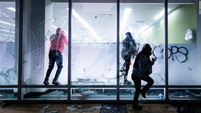 People vandalize a Walgreens store during protests in Oakland, California, on May 29.