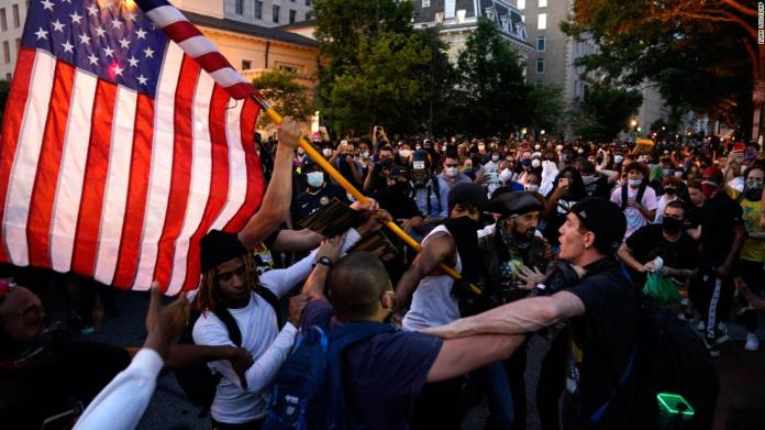 Demonstrators clash near the White House on May 30.