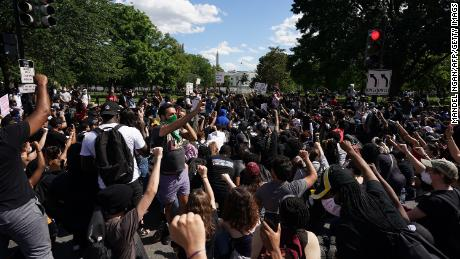 Demonstrators gather near the White House on Sunday.