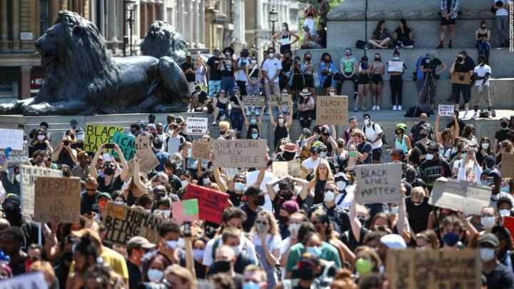 People hold placards as they join a Black Lives Matter march at Trafalgar Square in London on Sunday, May 31.