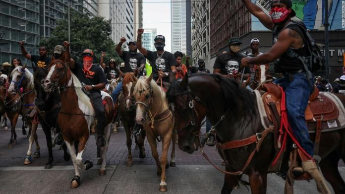 Protesters on horseback rally in downtown Houston on June 2.