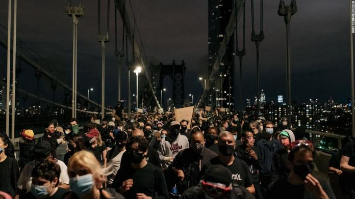 "Protesters walk off the Manhattan Bridge in New York after being blocked by police on June 2. Police were on both sides of the bridge as peaceful protesters were in the middle. Eventually the protesters <a href=""https://www.cnn.com/us/live-news/george-floyd-protests-06-02-20/h_b48733561b13603cd862ae3563a498b3"" target=""_blank"">were allowed to walk away</a> and leave the area."