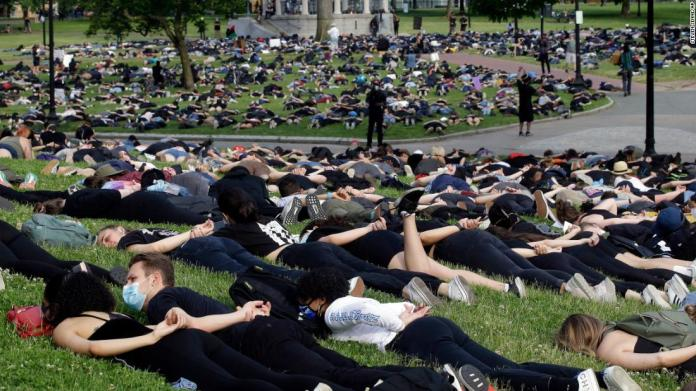 "Hundreds of demonstrators in Boston lie face down, symbolizing the last moments of George Floyd's life, on June 3. <a href=""https://www.cnn.com/2020/06/03/world/gallery/george-floyd-lie-down-intl-scli/index.html"" target=""_blank"">Related photos: Lie-in protests around the world</a>"