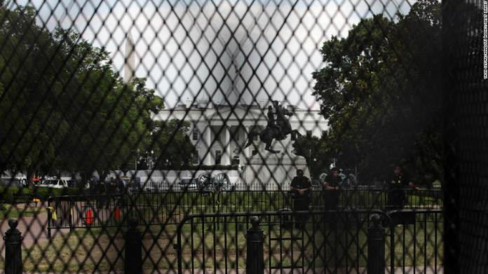 The White House is seen behind temporary metal fencing that was installed to keep protesters further back.