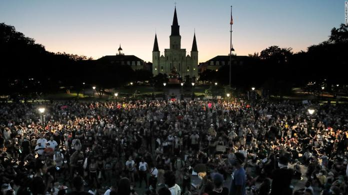 People attend a rally outside Jackson Square in New Orleans on June 5.