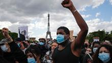 Demonstrators gather on the Champs de Mars in front of the Eiffel Tower during a demonstration in Paris Saturday.