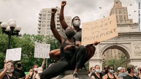 Demonstrators denouncing systemic racism and the police killings of black Americans rally in Washington Square Park on June 6, 2020, in New York City.