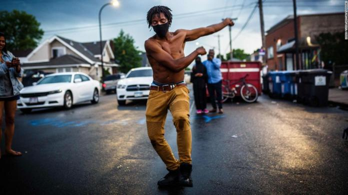 A man dances near Floyd's memorial in Minneapolis on June 6.