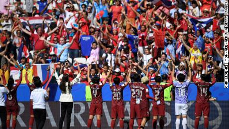 Thailand's players acknowledge their supporters at the end of the match against Sweden on June 16, 2019.