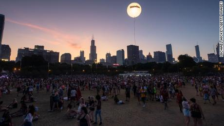 The sun sets on day four of Lollapalooza at Grant Park in Chicago, August 4, 2019.