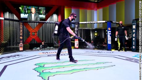 Workers sanitize the Octagon at UFC APEX, the UFC's bespoke arena.