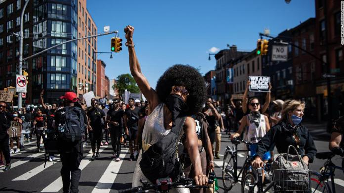 Demonstrators in New York make their way through Brooklyn on June 13.
