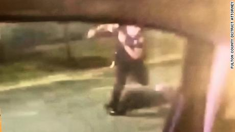 This still image taken from a bystander's video shows former Officer Garrett Rolfe kick Rayshard Brooks after he was shot, according to Fulton County District Attorney Paul Howard.