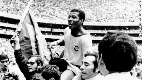 Brazilian forward Jairzinho is held aloft after Brazil's victory.