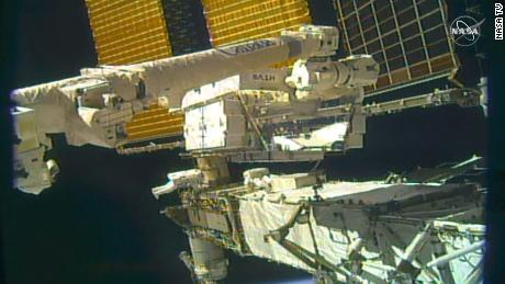 Astronauts work on the starboard end farm (S6 Truss) of the space station.