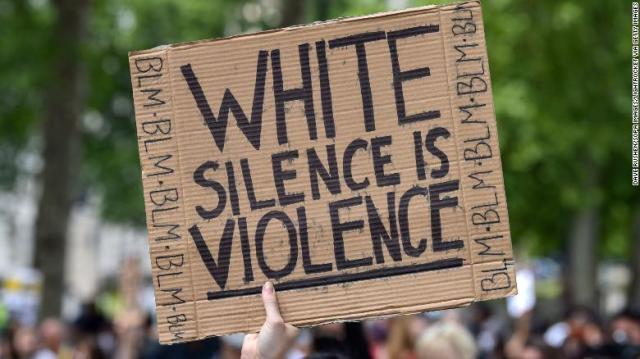 A protester holds up a poster during a Black Lives Matter demonstration in  London on June 21.