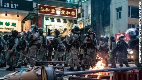 Riot police are seen in front of a burning roadblock during a protest against the new national security law on July 1, 2020 in Hong Kong.