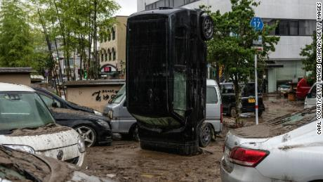 A car stands in front after being overturned by the floods after the nearby Kuma River broke out on July 5 in Hitoyoshi, Japan.