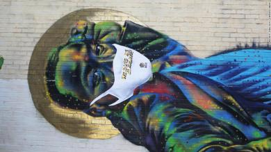 Black artists put face masks on street murals to fight Covid-19